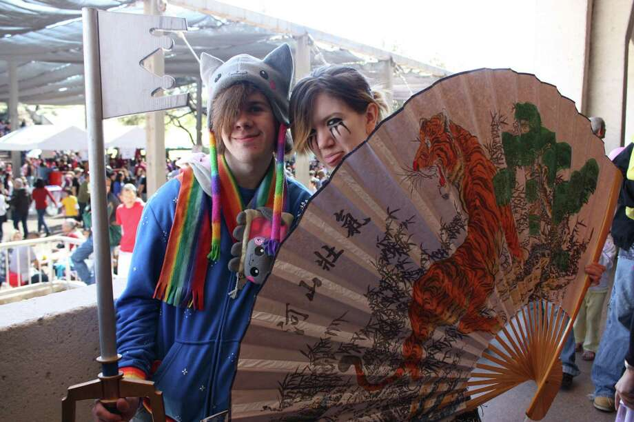 People celebrating 26th Annual Asian Festival at The Institute of Texan Cultures Photo: Libby Castillo