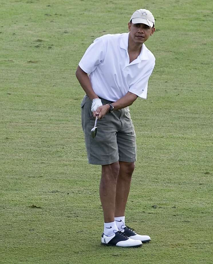 (FILES) Photo dated December 28, 2010 shows US President Barack Obama playing golf at the Mid Pacific Country Club in Kailua, Hawaii. Obama on February 15, 2013 will flee winter this long President's Day weekend and plans to polish his golf game on a stag weekend in balmy Florida, reportedly enlisting Butch Harmon, the coach who once schooled Tiger Woods.     AFP PHOTO/FILES/Saul LOEBSAUL LOEB/AFP/Getty Images Photo: Saul Loeb, AFP/Getty Images