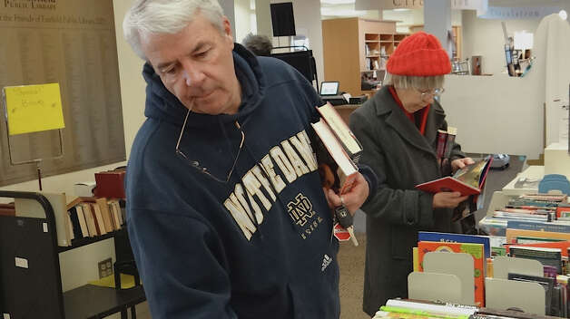 Jerry Keough of Fairfield checks out the books on offer Saturday at the Fairfield Public Library, the first day of its week-long President's Day Book Sale.  FAIRFIELD CITIZEN, CT 2/16/13 Photo: Mike Lauterborn / Fairfield Citizen contributed