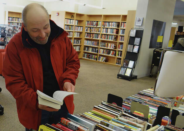 John Hanninen of Fairfield looks over some of the fiction books available Saturday at the Fairfield Public Library's President's Day Book Sale.  FAIRFIELD CITIZEN, CT 2/16/13 Photo: Mike Lauterborn / Fairfield Citizen contributed