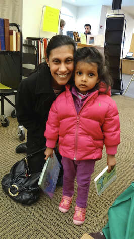 Sonal Shah Rajan of Fairfield and daughter Kiran came to the Presdient's Day Book Sale on Saturday at the Fairfield Public LIbrary to look for some children's books.  FAIRFIELD CITIZEN, CT 2/16/13 Photo: Mike Lauterborn / Fairfield Citizen contributed
