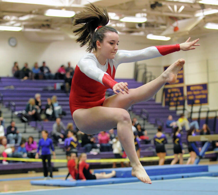 Emily Clarke of Greenwich High School competes in the floor exercise during the 2013 FCIAC Girls Gymnastics Championships at Westhill High School in Stamford, Saturday, Feb. 16, 2013. Photo: Bob Luckey / Greenwich Time