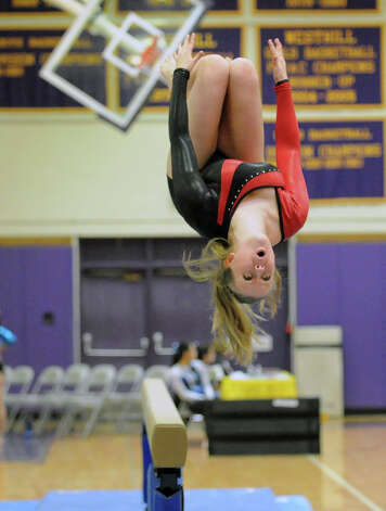 Judith Klinga of Fairfield-Warde High School dismounts from the balance beam during the 2013 FCIAC Girls Gymnastics Championships at Westhill High School in Stamford, Saturday, Feb. 16, 2013. Photo: Bob Luckey / Greenwich Time