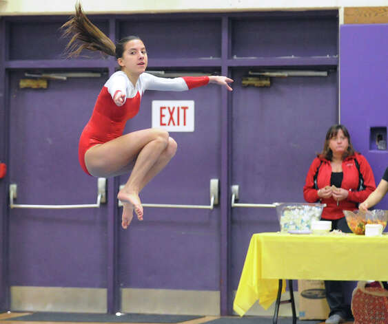 Victoria Houson of Greenwich High School competes in the floor exercise during the 2013 FCIAC Girls Gymnastics Championships at Westhill High School in Stamford, Saturday, Feb. 16, 2013. Photo: Bob Luckey / Greenwich Time