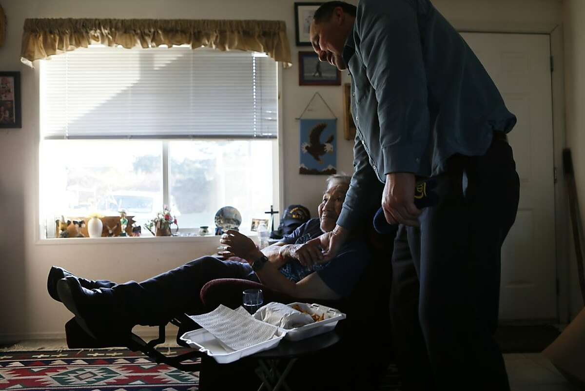 Jim McQuillen, education director of the Yurok tribe, visits tribal elder Archie Thompson, 93. McQuillen, who oversees the program to revive the Yurok language, has learned much from elders like Thompson. (Robert Gauthier/Los Angeles Times/MCT)