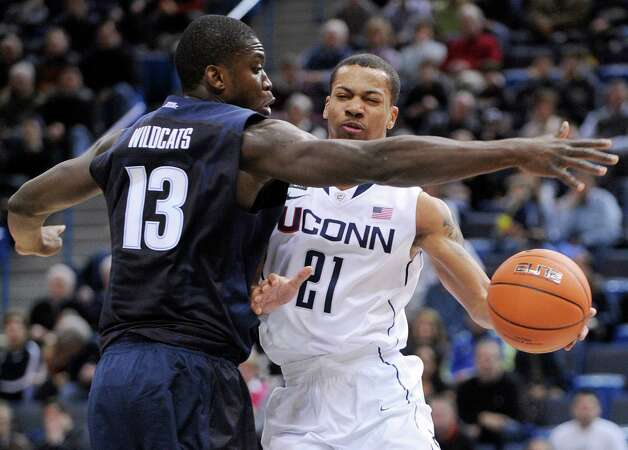 Connecticut's Omar Calhoun, right, is guarded by Villanova's Mouphtaou Yarou during the first half of an NCAA college basketball game in Hartford, Conn., Saturday, Feb. 16, 2013. Villanova won the game 70-61. (AP Photo/Fred Beckham) Photo: Fred Beckham, Associated Press / FR153656 AP