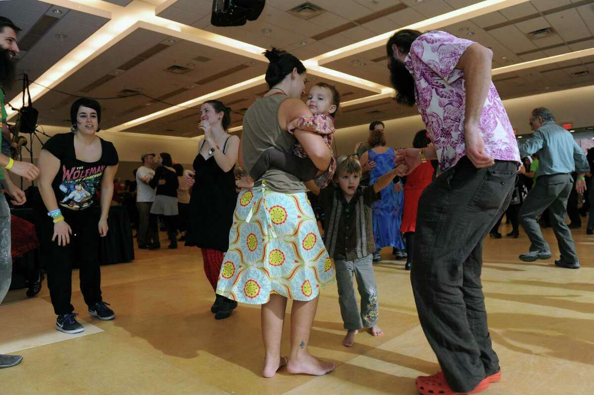 Gretchen Terrell holds her daughter Minka while her husband Davis Terrell and son Wilder dance as a family during a Cajun dance party as part of Dance Flurry on Saturday Feb. 16, 2013 in Saratoga Springs, N.Y. .(Michael P. Farrell/Times Union)