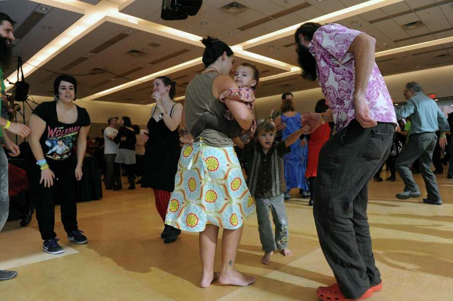 Gretchen Terrell holds her daughter Minka while her husband Davis Terrell and son Wilder dance as a family during a Cajun dance party as part of Dance Flurry on Saturday Feb. 16, 2013 in Saratoga Springs, N.Y. .(Michael P. Farrell/Times Union) Photo: Michael P. Farrell