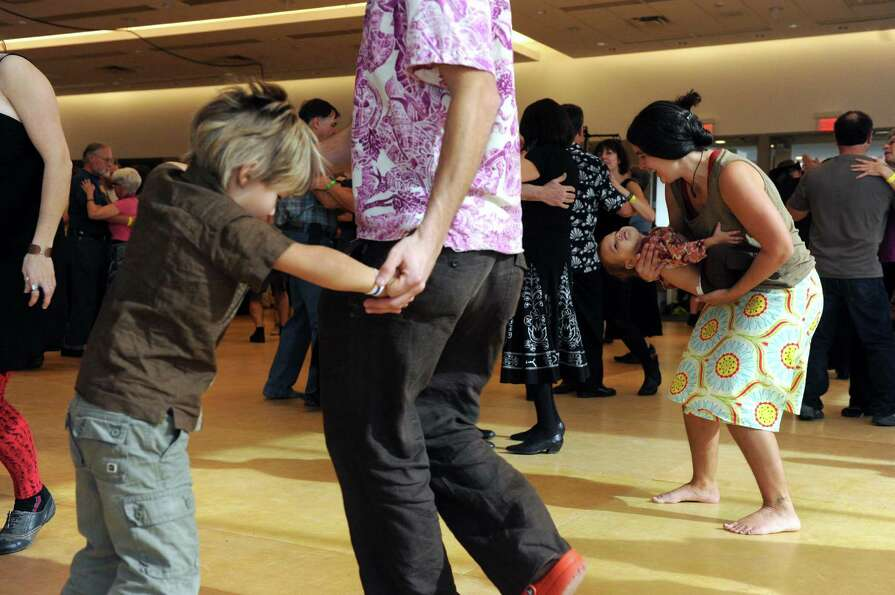 Gretchen Terrell, right, dances daughter Minka during a Cajun dance party as part of Dance Flurry on