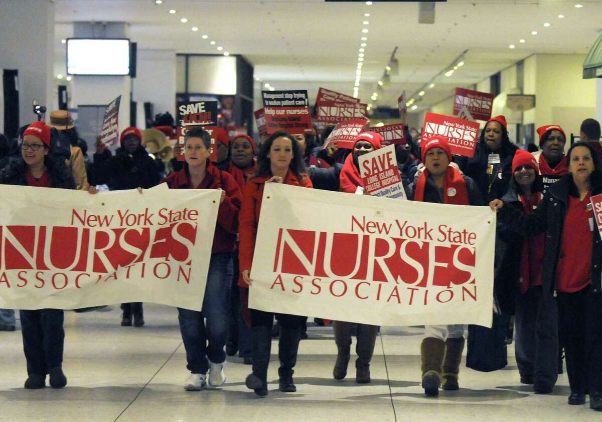 Nurses and patients march through the Empire State Plaza Concourse to protest plans to close several downstate hospital and allow hedge funds to establish for-profit hospitals at the Capitol on Saturday Feb. 16, 2013 in Albany, N.Y. .(Michael P. Farrell/Times Union)