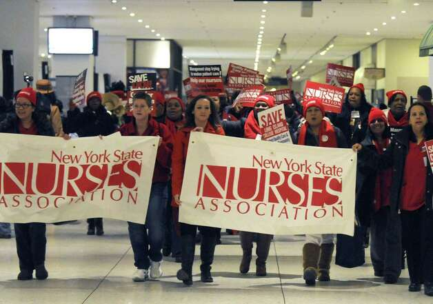 Nurses and patients march through the Empire State Plaza Concourse to protest plans to close several downstate hospital and allow hedge funds to establish for-profit hospitals at the Capitol on Saturday Feb. 16, 2013 in Albany, N.Y. .(Michael P. Farrell/Times Union) Photo: Michael P. Farrell