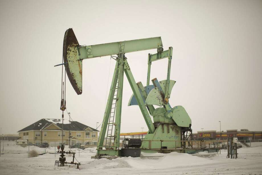 Work in the Bakken Oil Fields of North Dakota has brought an influx of thousands or workers, making North Dakota the fastest growing state in America. Photo: Jeff Wheeler / Minneapolis Star Tribune