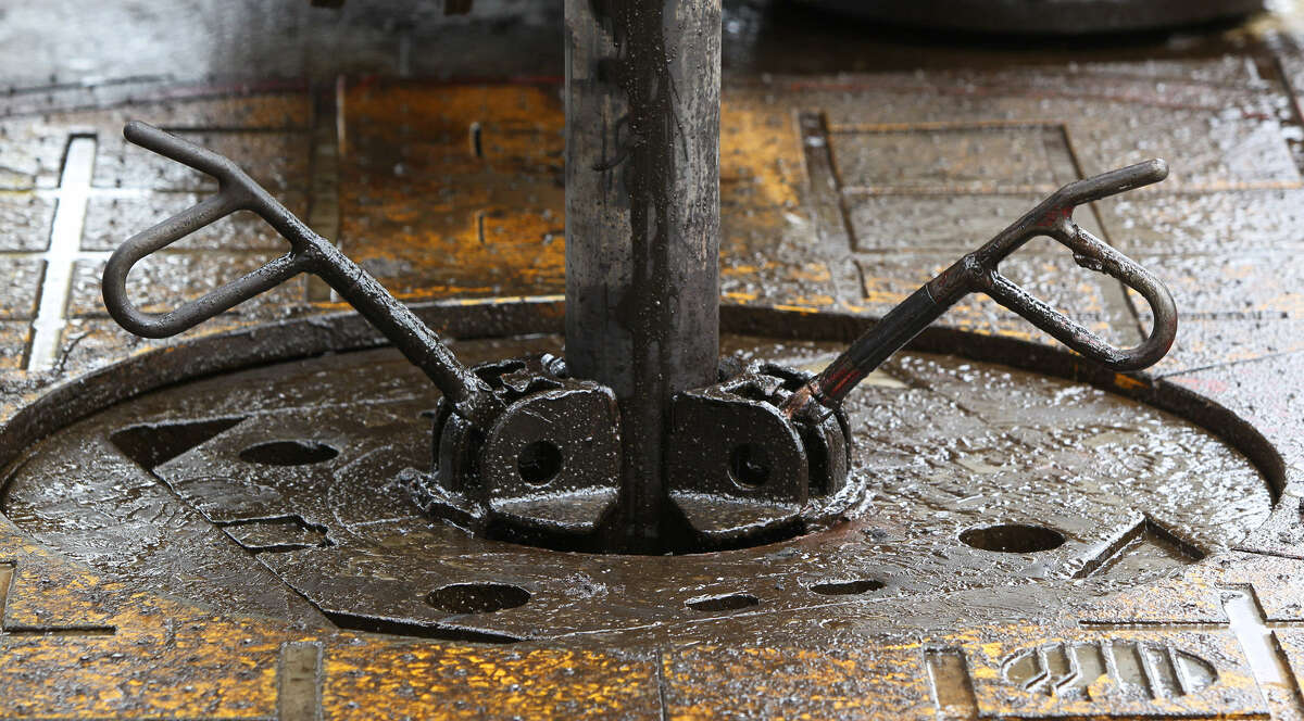 Drilling pipe enters the floor of the platform on a rig in McMullen County over the Eagle Ford Shale formation.