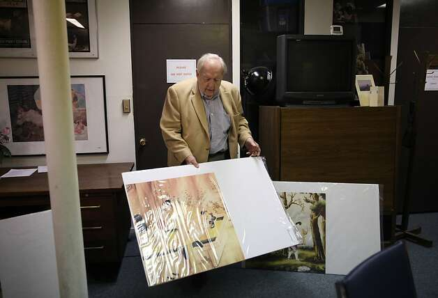 Reverend Ted McIlvenna removes some Chinese erotic art posters from a closet at the Institute for Advanced Study of Human Sexuality on Thursday, February 14, 2013 in San Francisco, Calif. McIlvenna will be bringing the art to China with the special delegation invited by the  China Sexology Association. Photo: Lea Suzuki, The Chronicle