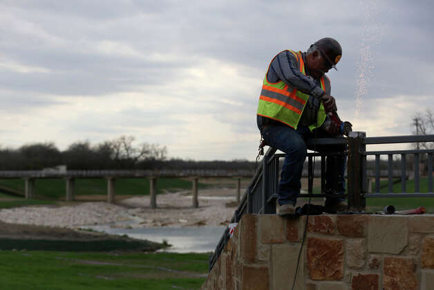 Zaragoza Maldonado works as construction and landscaping continues along the Mission Reach of the San Antonio River in San Antonio on Friday, Feb. 15, 2013. Photo: Lisa Krantz, San Antonio Express-News / © 2012 San Antonio Express-News