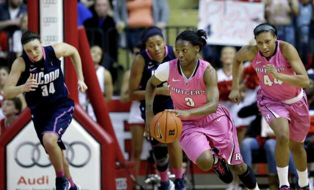 Rutgers' Erica Wheeler (3) drives up the court during the second half of an NCAA college basketball game against Connecticut Saturday, Feb. 16, 2013, in Piscataway, N.J. Connecticut won 65-45. (AP Photo/Mel Evans) Photo: Mel Evans, Associated Press / AP