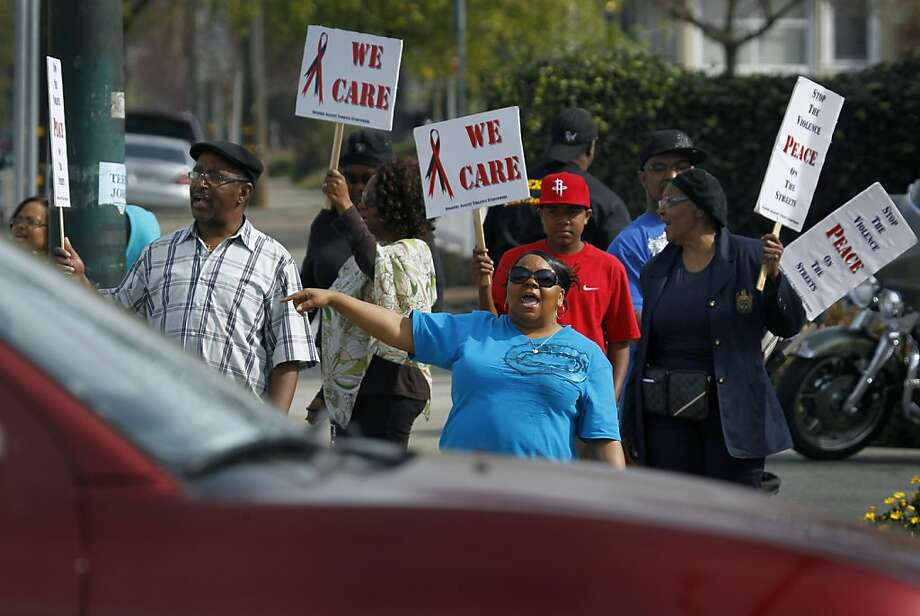 True Vine Ministries parishioners rally against violence Saturday at MacArthur Boulevard and High Street. Photo: Paul Chinn, The Chronicle