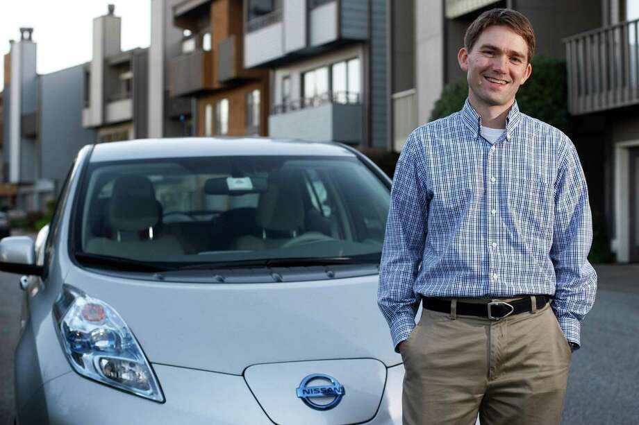 Pennan Barry of Richmond, Calif., says his Nissan Leaf costs no more to operate than his old Subaru, even with a lease payment  - and it is fun to drive. Photo: James Tensuan, Staff / ONLINE_YES
