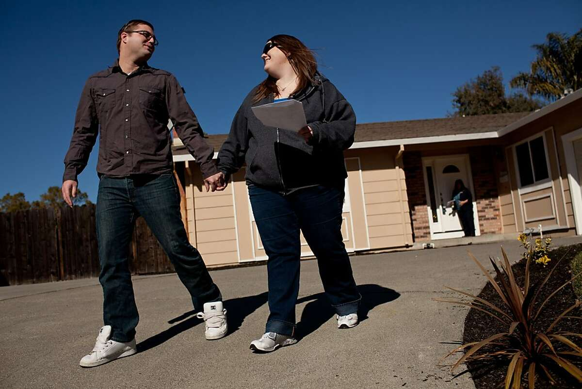 Brian, left, and Kim Norden leave a home while shopping for their first home February 15, 2013 in Vacaville, California. A forecast from Zillow shows almost all Bay Area ZIP codes should expect healthy appreciation in home values this year.