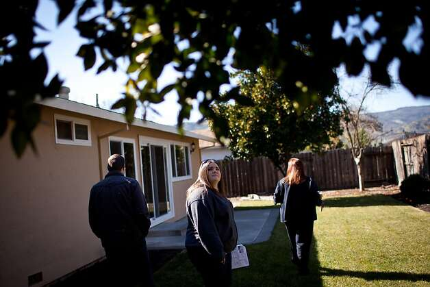 His wife, Kim Norden, tours a backyard in Vacaville while the couple shop for their first home. Photo: Max Whittaker/Prime, Special To The Chronicle