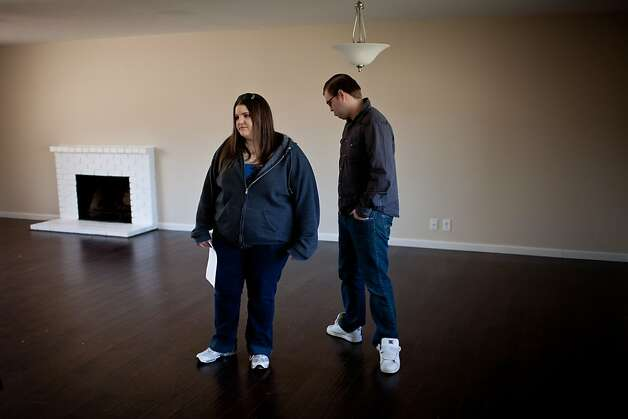 Brian, left, and Kim Norden tour a home while shopping for their first home February 15, 2013 in Vacaville, California. A forecast from Zillow shows almost all Bay Area ZIP codes should expect healthy appreciation in home values this year. Photo: Max Whittaker/Prime, Special To The Chronicle