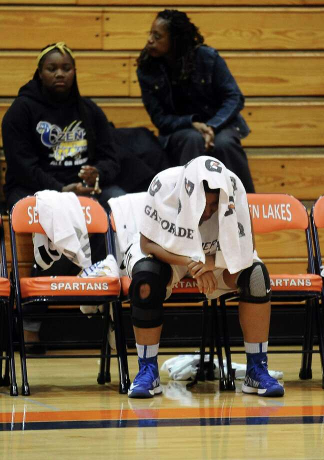 Ozen High School Lady Panther Alexandra Moten, #32, does not leave the bench after a loss to the Pflugerville Connally High School Lady Cougars 43 - 47 at Seven Lakes High School in Katy on Friday, February 15, 2013.  Photo taken: Randy Edwards/The Enterprise Photo: Randy Edwards
