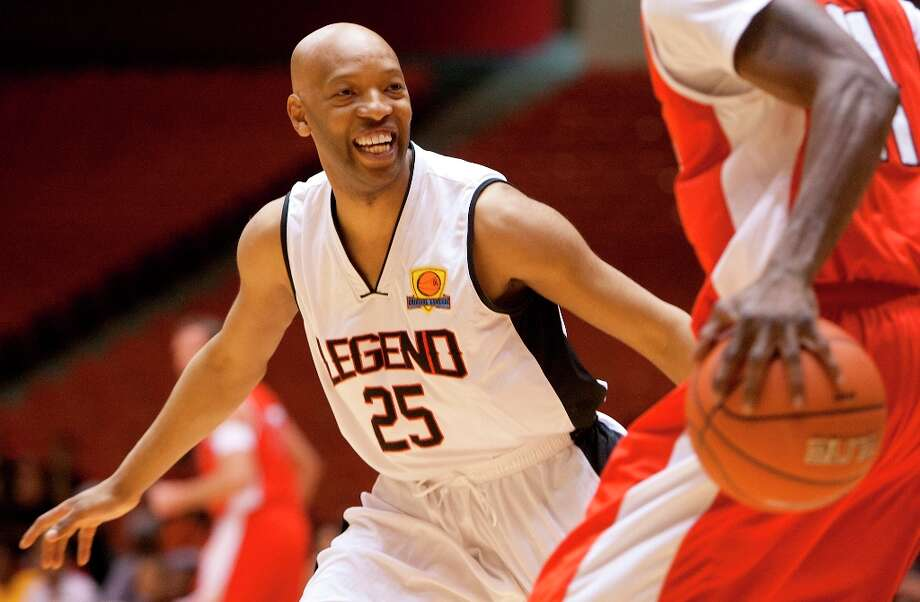 Former Rocket Sam Cassell smiles as he taunts an opponent during Saturday's game at Hofheinz Pavilion on the University of Houston campus. Photo: Cody Duty / © 2013 Houston Chronicle