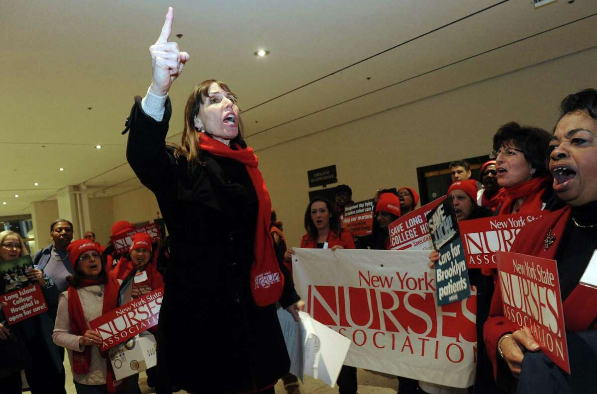 Jill Furillo, excutive director of NYSNA , speaks following a march by nurses and patients through the Empire State Plaza Concourse to protest plans to close several downstate hospitals and allow hedge funds to establish for-profit hospitals at the Capitol on Saturday Feb. 16, 2013 in Albany, N.Y. .(Michael P. Farrell/Times Union)