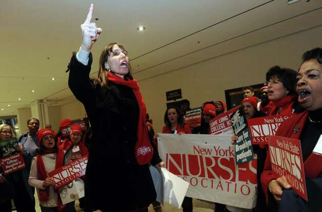Jill Furillo, excutive director of NYSNA , speaks following a march by nurses and patients through the Empire State Plaza Concourse to protest plans to close several downstate hospitals and allow hedge funds to establish for-profit hospitals at the Capitol on Saturday Feb. 16, 2013 in Albany, N.Y. .(Michael P. Farrell/Times Union) Photo: Michael P. Farrell