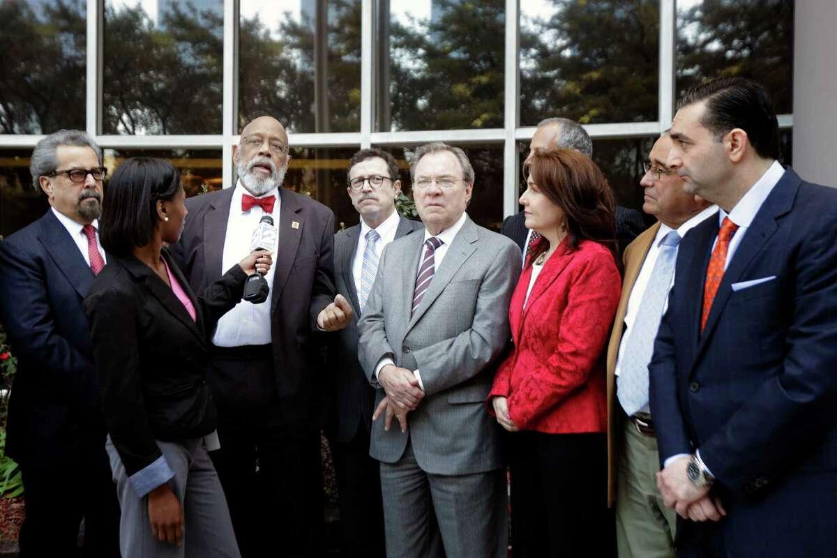 Former Congressman Craig Washington speaks alongside other lawyers outside the federal courthouse, defending Judge Lynn Hughes.