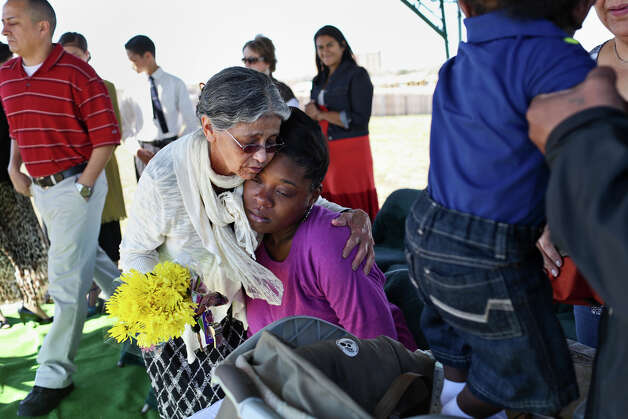 Rosa Rohena embraces Shontae Minor during the funeral for Minor's son and Rohena's grandson, Ryan Rohena, the second of Minor's quadruplets to pass away, at Chapel Hill Memorial Park cemetery in San Antonio on Thursday, Feb. 14, 2013. Photo: LISA KRANTZ, San Antonio Express-News / SAN ANTONIO EXPRESS-NEWS