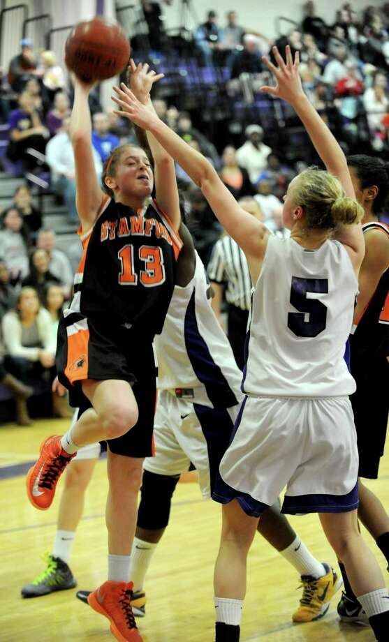 Stamford's Maxine Fodiman takes a shot during Saturday's FCIAC quarterfinal game at Westhill High School on February 16, 2013. Photo: Lindsay Perry / Stamford Advocate