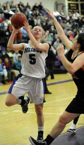 Westhill's Steph Roones takes a shot during Saturday's FCIAC quarterfinal game against Stamford at Westhill High School on February 16, 2013. Photo: Lindsay Perry / Stamford Advocate