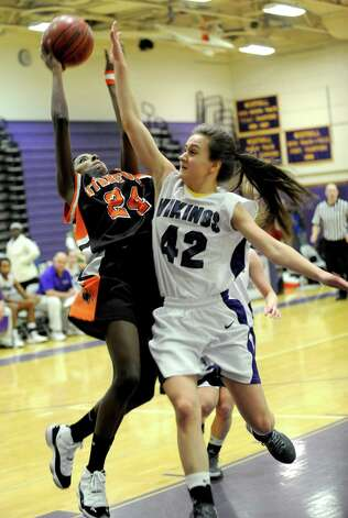 Stamford's Tiana England takes a shot as she is defended by Westhill's Samantha Grosso during Saturday's FCIAC quarterfinal game at Westhill High School on February 16, 2013. Photo: Lindsay Perry / Stamford Advocate