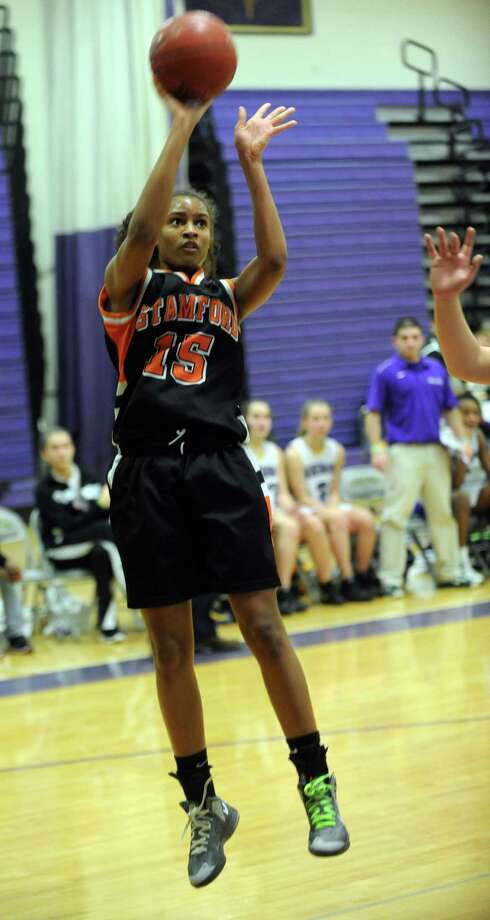Stamford's Anisa Fortt takes a shot during Saturday's FCIAC quarterfinal game at Westhill High School on February 16, 2013. Photo: Lindsay Perry / Stamford Advocate