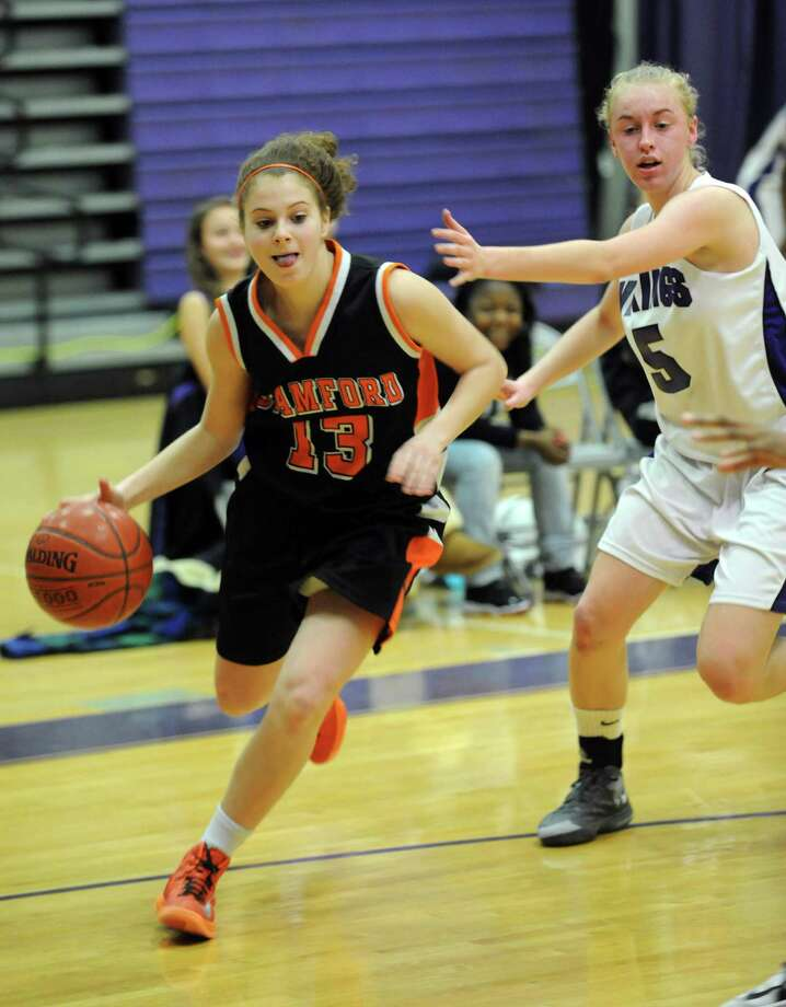 Stamford's Maxine Fodiman controls the ball during Saturday's FCIAC quarterfinal game at Westhill High School on February 16, 2013. Photo: Lindsay Perry / Stamford Advocate