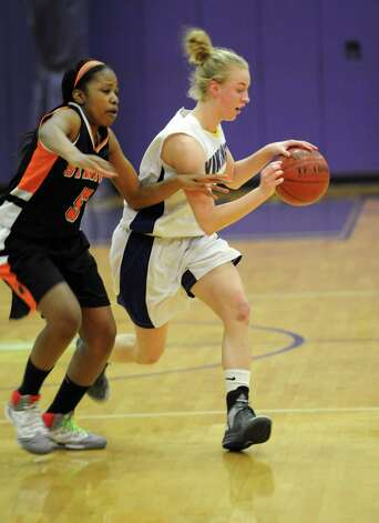 Westhill's Steph Roones controls the ball during Saturday's FCIAC quarterfinal game against Stamford at Westhill High School on February 16, 2013. Photo: Lindsay Perry / Stamford Advocate