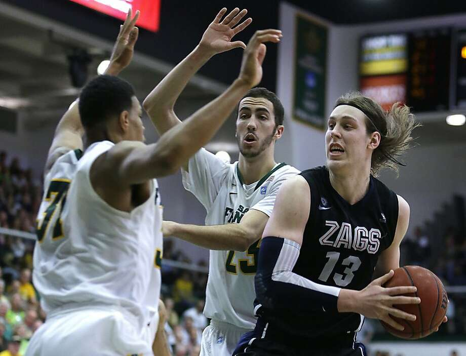 San Francisco's Frank Rogers, left, and Mark Tollefsen defend against Gonzaga's Kelly Olynyk (13) during the second half of an NCAA college basketball game, Saturday, Feb. 16, 2013, in San Francisco. (AP Photo/Ben Margot) Photo: Ben Margot, Associated Press
