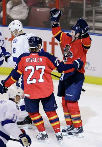 Florida Panthers' Jerred Smithson, right, celebrates with teammate Alex Kovalev (27) after scoring the game tying goal, 3-3, against the Tampa Bay Lightning in the second period of an NHL hockey game in Sunrise, Fla., Saturday, Feb. 16, 2013. (AP Photo/Alan Diaz) Photo: Alan Diaz