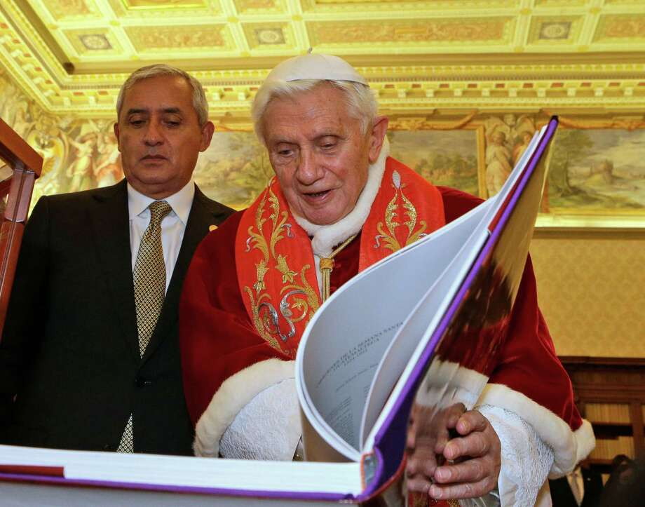 Pope Benedict XVI exchanges gifts with Guatemala's President Otto Perez Molina,  during a private audience at Vatican, Saturday, Feb. 16, 2013. (AP Photo/Alessandra Tarantino,  pool) Photo: Alessandra Tarantino / AP POOL