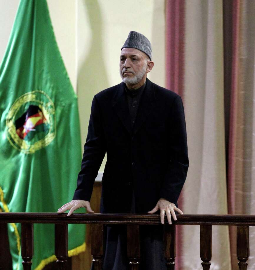 "Afghan President Hamid Karzai addesses military officers in Kabul, Afghanistan, Saturday, Feb. 16, 2013. Afghan President Hamid Karzai said Saturday he plans to issue a decree banning Afghan security forces from asking international troops to carry out airstrikes under ''any circumstances."" The announcement came amid anger over a joint Afghan-NATO operation this week that Afghan officials said killed 10 civilians, including women and children, in northeast Kunar province.(AP Photo/Ahmad Jamshid) Photo: Ahmad Jamshid"