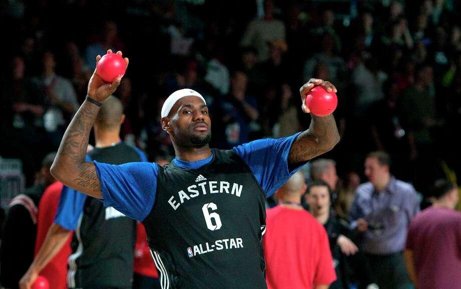 LeBron James throws balls to the crowd. Photo: Cody Duty / © 2013 Houston Chronicle