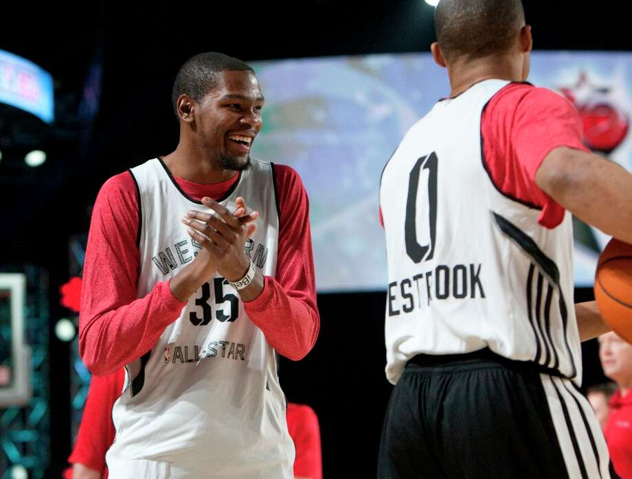 Oklahoma City Thunder's Kevin Durant, left, laughs with teammate Kevin Westbrook during All-Star practice at the George R. Brown Convention Center, Saturday, Feb. 16, 2013, in Houston. Photo: Cody Duty / © 2013 Houston Chronicle