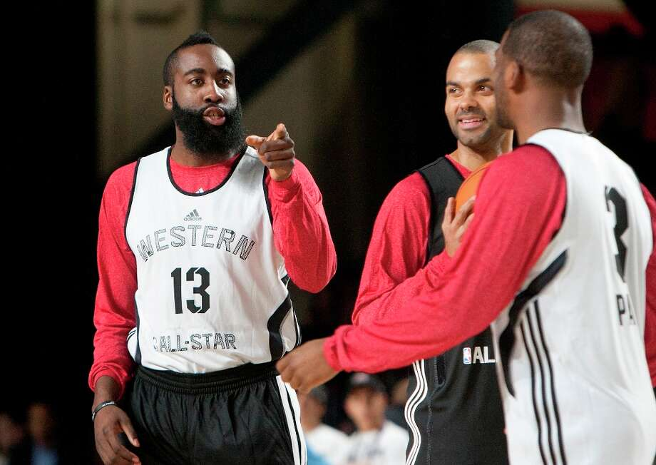 James Harden, left, points a finger at Chris Paul as Tony Parker, center, looks on. Photo: Cody Duty / © 2013 Houston Chronicle