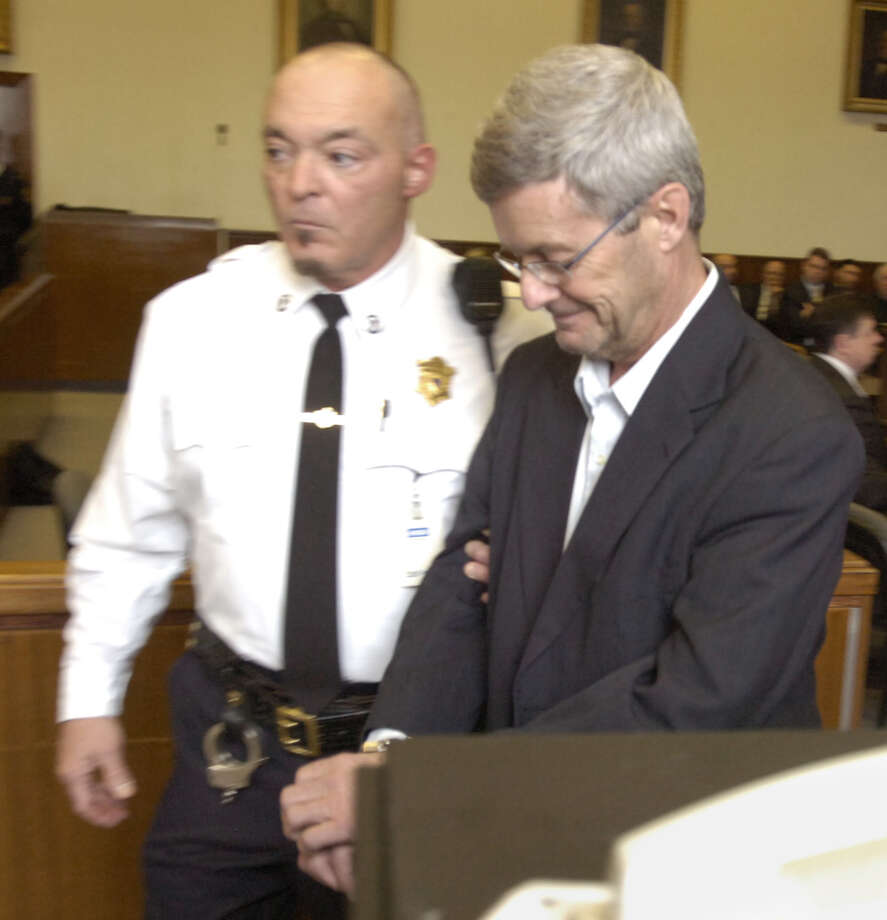Gary Mercure, right, the priest accused of raping two altar boys in the 1980s, is sentenced in Berkshire County Superior Court in 2011. (Mike McMahon / The Record) Photo: MIKE MCMAHON / THE RECORD