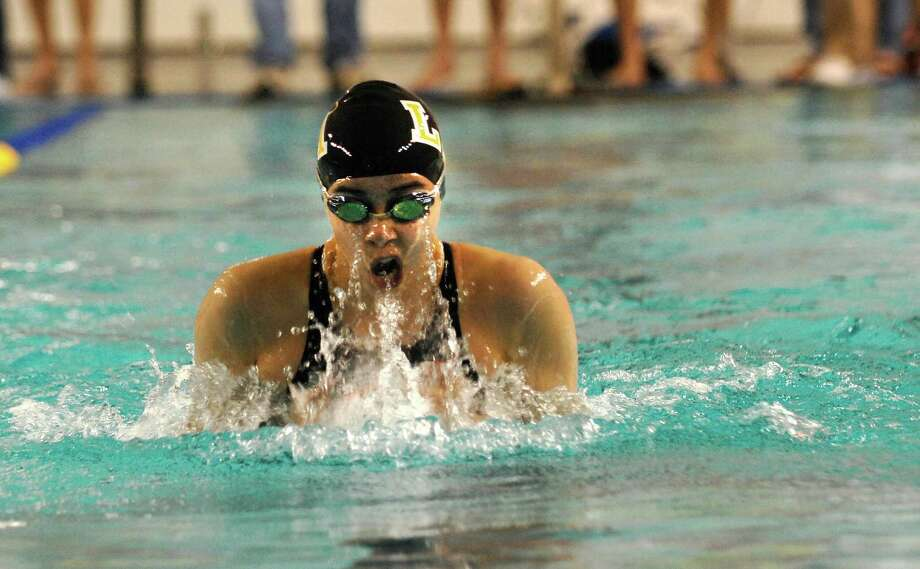 A swimmer competes in the Women's 100 Yard Breaststroke during the Texas Association of Private and Parochial Schools state swimming meet at Josh Davis Natatorium, Feb 16, 2013. Photo: Steve Faulisi, San Antonio Express-News / ©2013 San Antonio Express-News