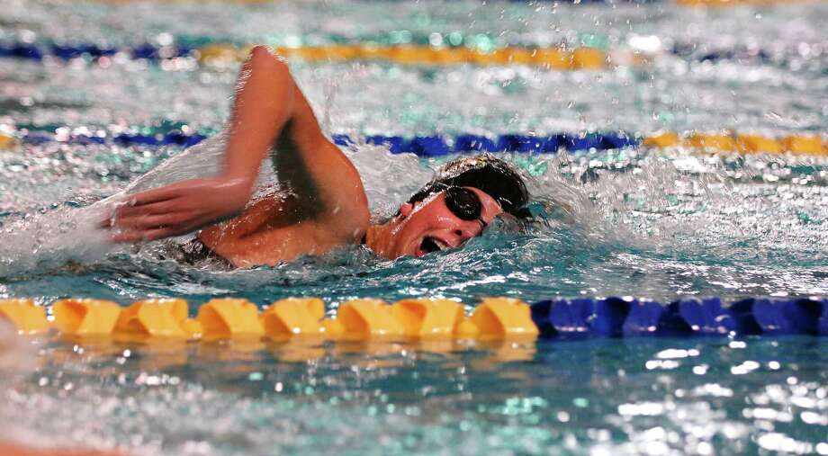 A swimmer competes in the Men's 50 yard Freestyle during the Texas Association of Private and Parochial Schools state swimming meet at Josh Davis Natatorium, Feb 16 , 2013. Photo: Steve Faulisi, San Antonio Express-News / ©2013 San Antonio Express-News