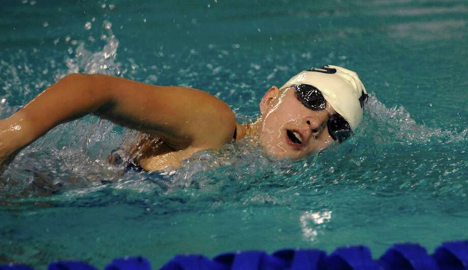 A member of San Antonio's Providence High School For Young Women competes in the Women's  400 yard Freestyle Relay during the Texas Association of Private and Parochial Schools state swimming meet at Josh Davis Natatorium, Feb 16, 2013. Photo: Steve Faulisi, San Antonio Express-News / ©2013 San Antonio Express-News