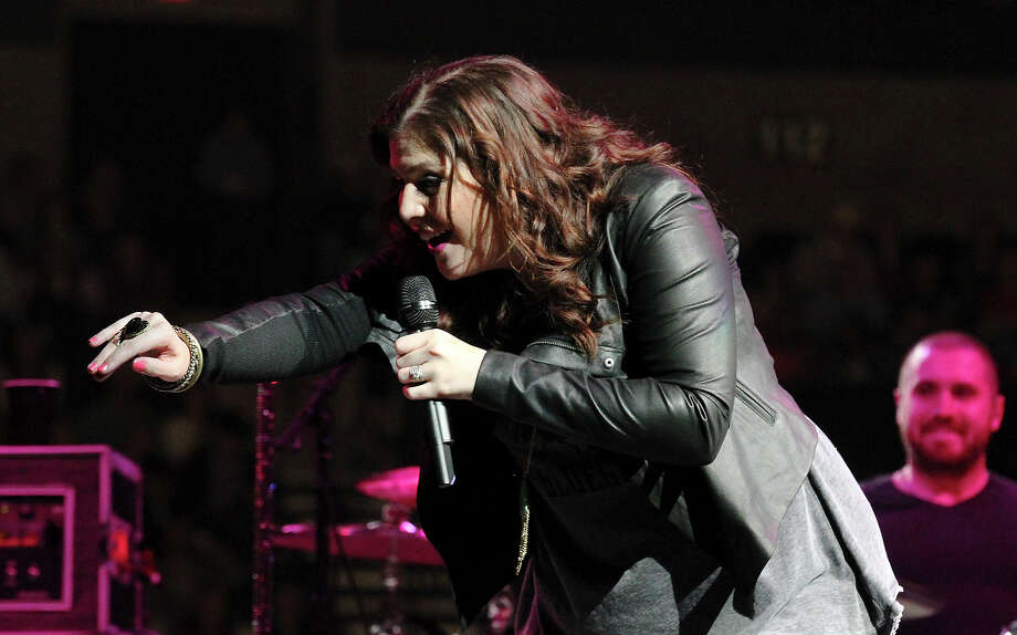 Lady Antebellum's HIllary Scott waves to an audience member during a performance at the San Antonio Stock Show and Rodeo on Saturday, Feb. 16, 2013. Photo: Kin Man Hui, San Antonio Express-News / © 2012 San Antonio Express-News