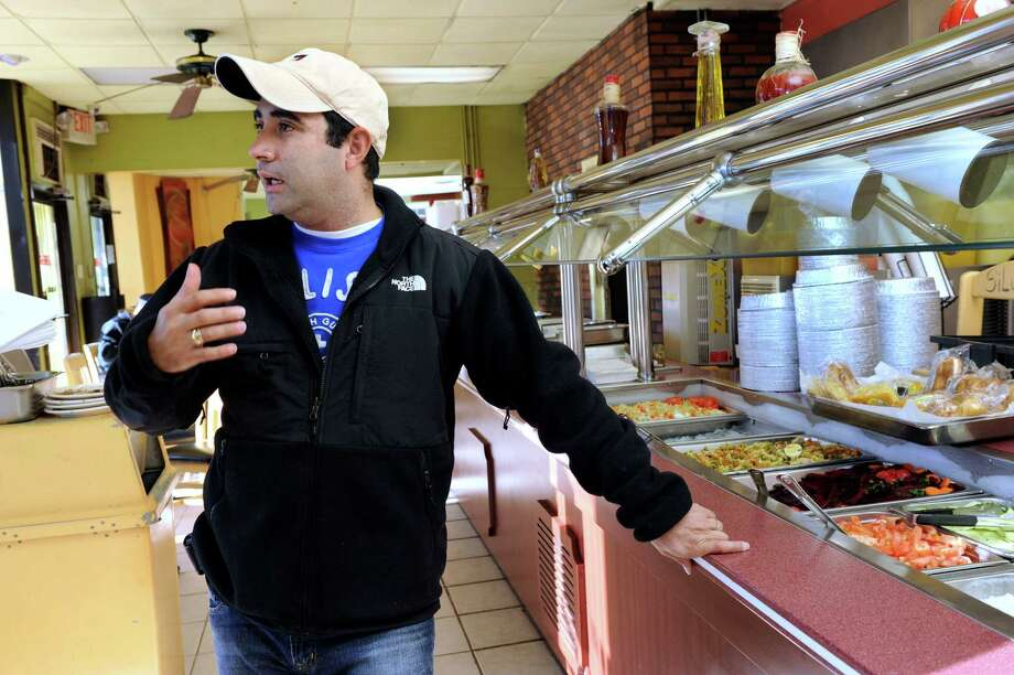 Nilton Coelho, is the owner of Banana Brazil on Main Street in Danbury. Photo: Carol Kaliff / The News-Times